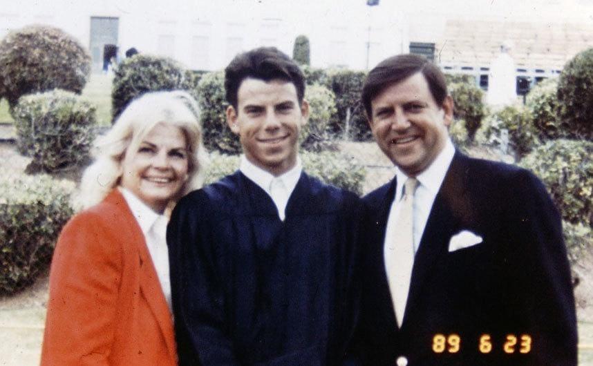 Erik Menendez with his parents posing on his graduation day