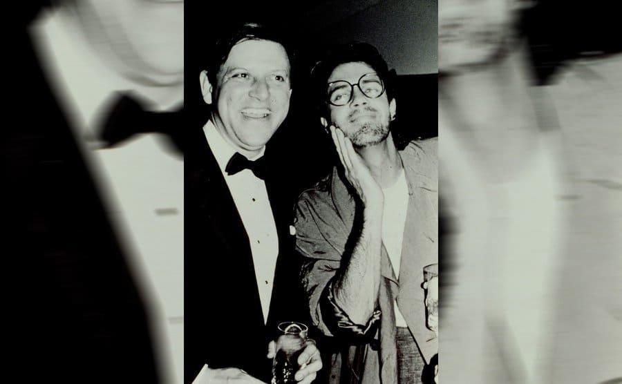 Jose Menendez and Rick Springfield posing at RCA Records
