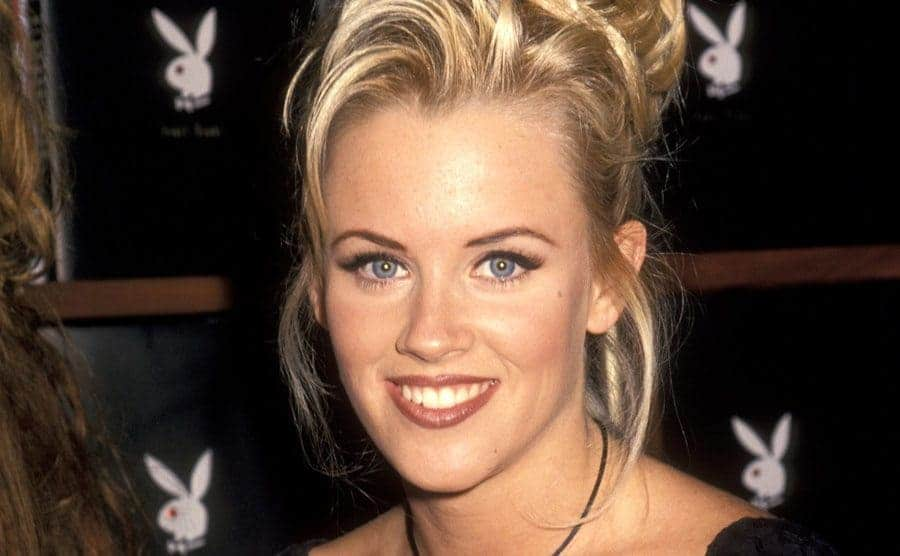 Jenny McCarthy in front of Playboy bunny symbols