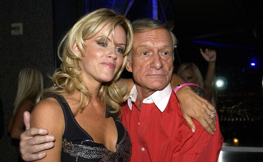 Jenny McCarthy with Hugh Hefner posing at an event