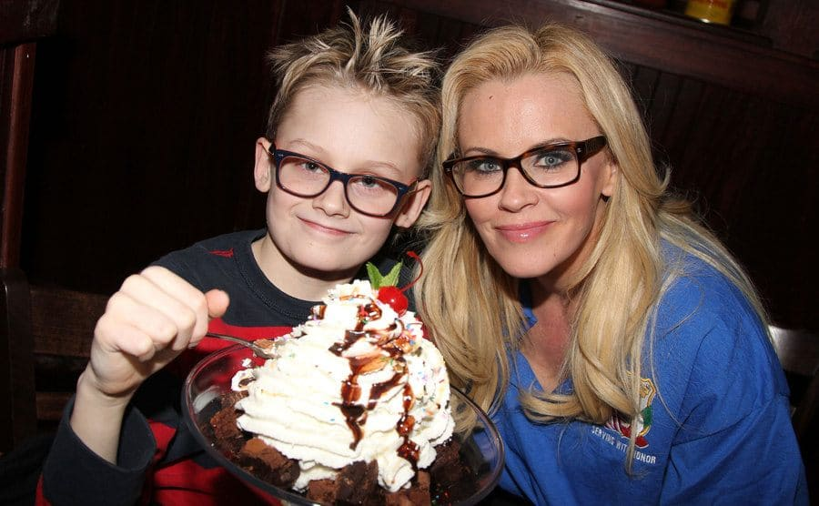 Evan Joseph Asher and Jenny McCarthy sitting together with a large ice cream Sunday in front of them with a cherry on top
