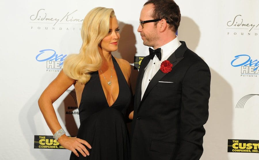 Jenny McCarthy and Donnie Wahlberg on the red carpet looking into each other's eyes