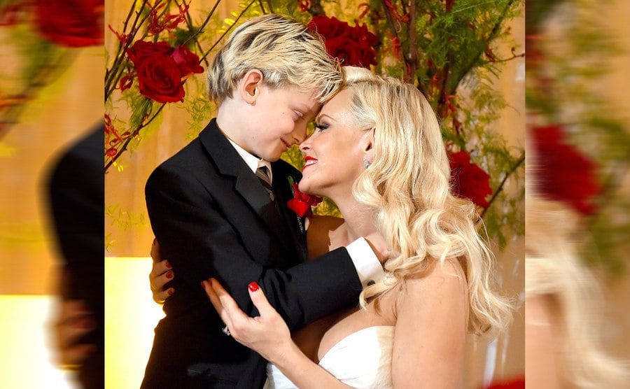 Evan and Jenny McCarthy on her wedding day posing together