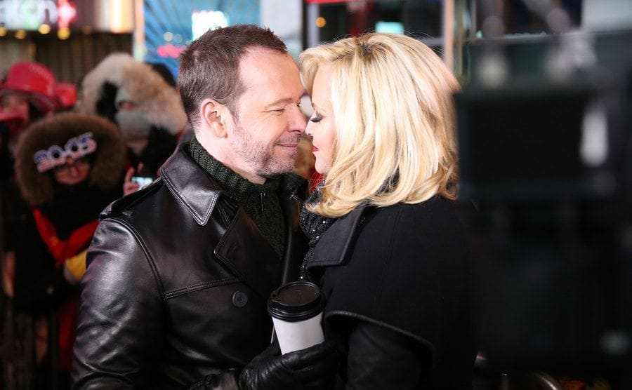Donnie and Jenny about to kiss looking very in love in Times Square