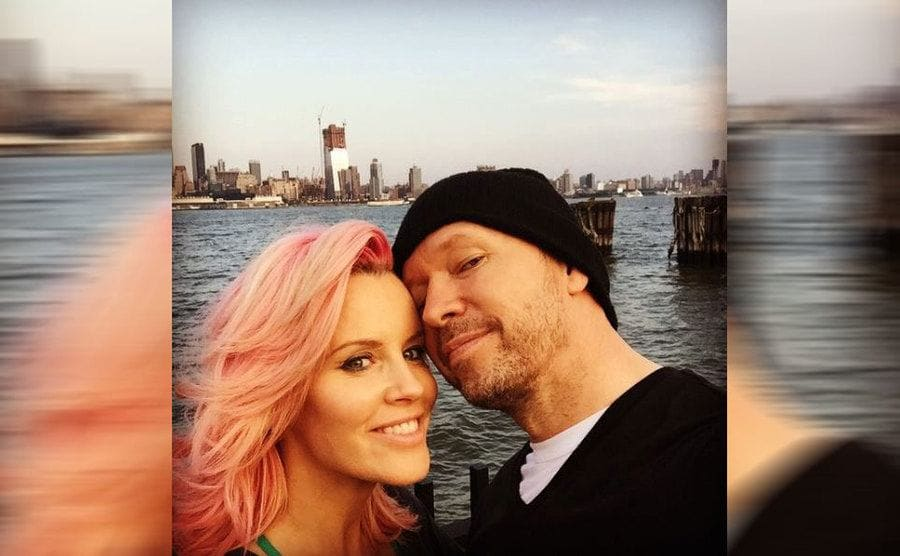Jenny McCarthy and Donnie Wahlberg in front of the water
