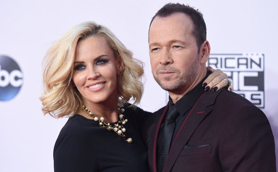 Jennie McCarthy and Donnie Wahlberg arriving at an event