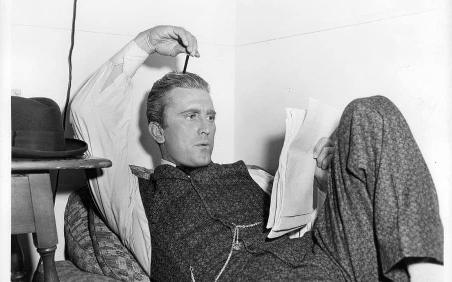 Kirk Douglas laying in the dressing room in a scene from the film 'The Big Trees'