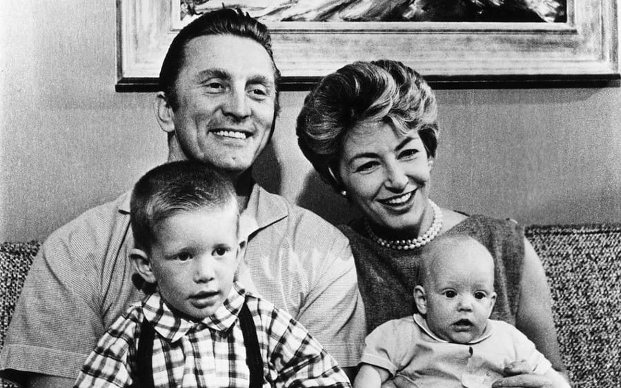 Douglas, Kirk with his wife Anne Buydens and their children