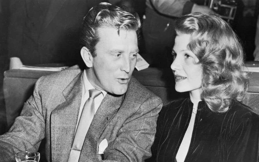 Rita Hayworth sits with actor Kirk Douglas at a Sunset Strip nightclub in Hollywood