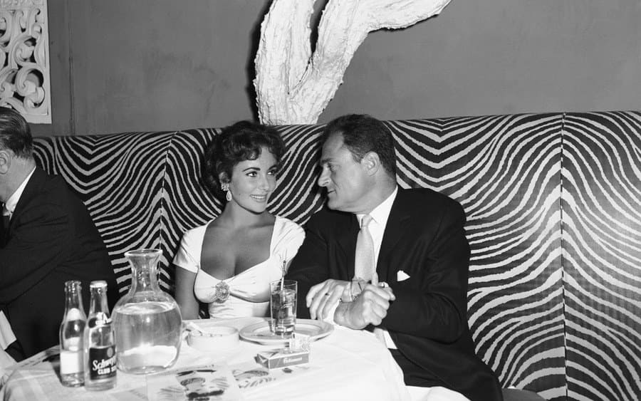Actress Elizabeth Taylor with producer Mike Todd at the El Morocco nightclub