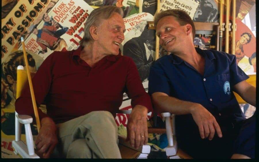 American actor Kirk Douglas shares a joke with his son, Eric