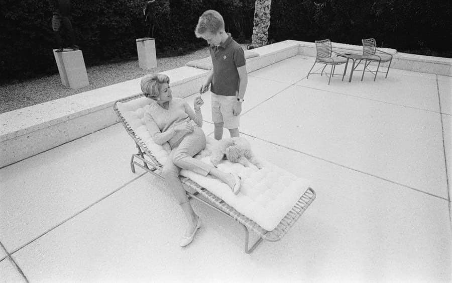 Anne Buydens, wife of American actor Kirk Douglas, with their son Eric