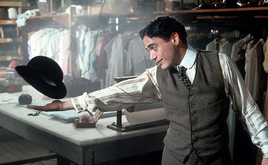 Robert Downey, Jr playing with his hat in a scene from Chaplin