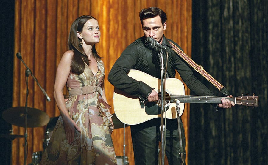 Reese Witherspoon and Joaquin Phoenix performing in a scene from Walk the Line