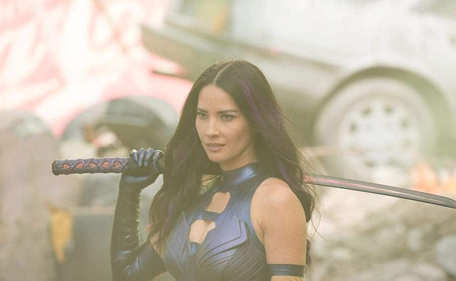 Olivia Munn holding a sword
