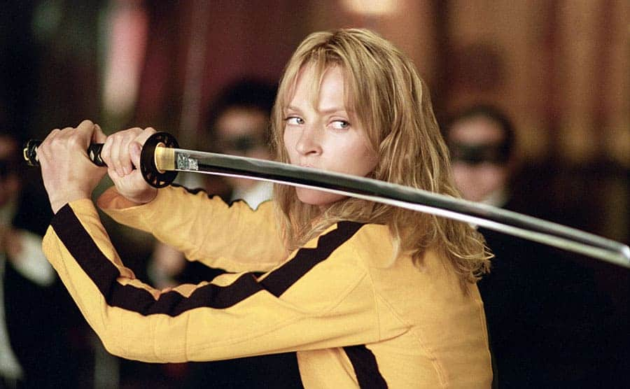 Uma Thurman posing in a stance with a sword