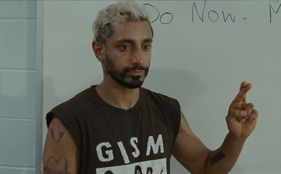Riz Ahmed signing in a scene from Sound of Metal