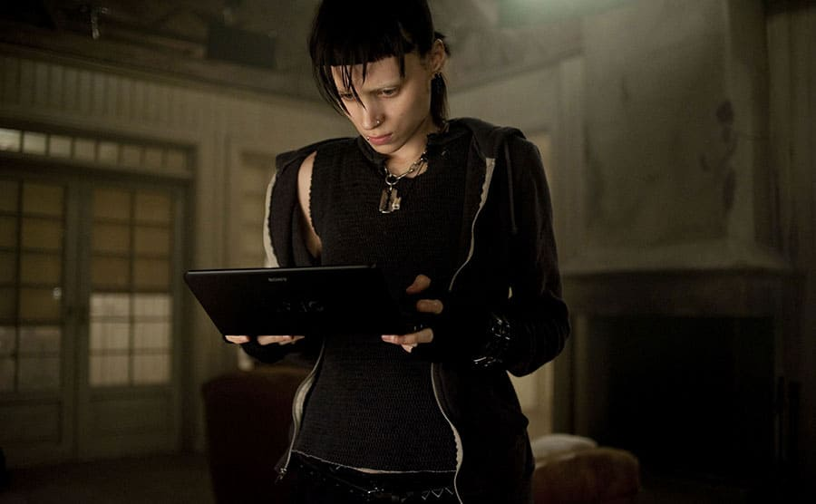 Rooney mara holding a small laptop