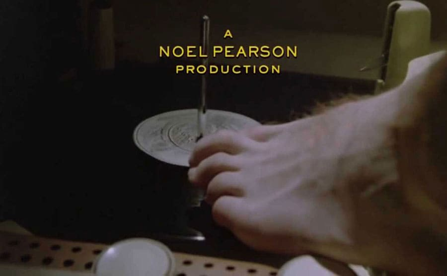 Daniel Day-Lewis putting a record on a turntable in the opening scene from My Left Foot