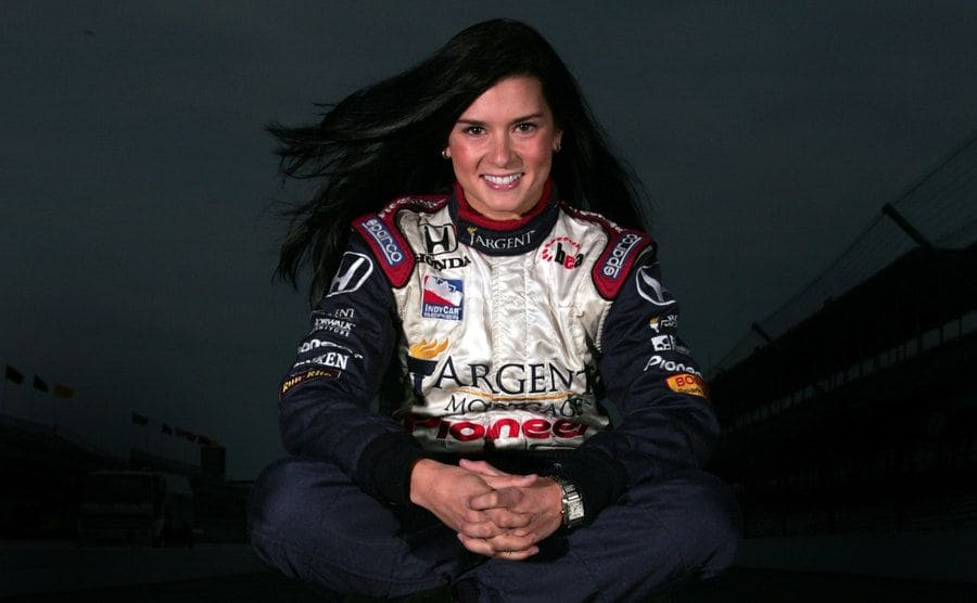 Danica Patrick poses for a portrait sitting on a Firestone tire at the Indianapolis Motor Speedway
