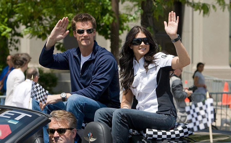Paul Hospenthal and Danica Patrick waving from the back of a convertible