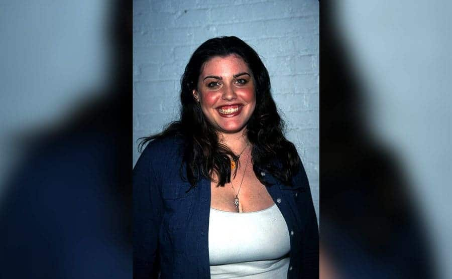 Actress Mia Tyler, Liv Tyler's half-sister, poses backstage at the Lane Bryant Spring 2000 intimate apparel collection fashion show.