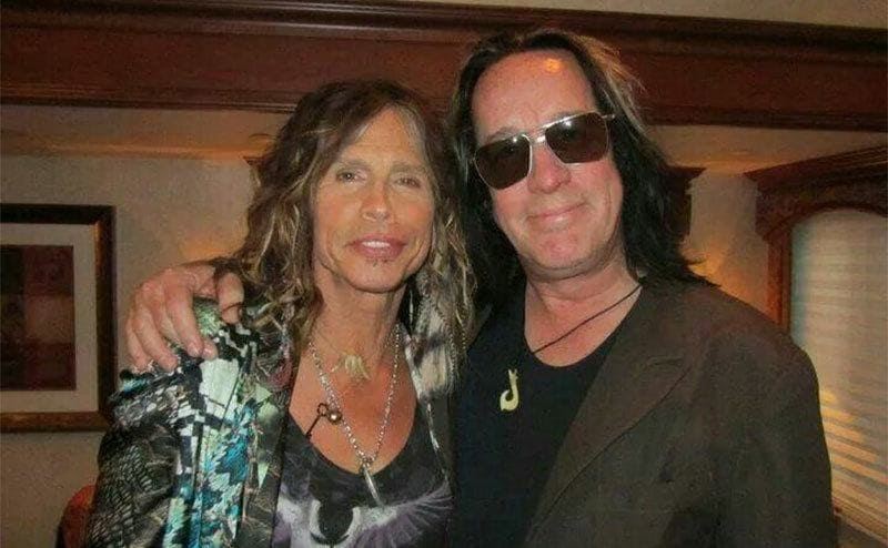 Rundgren and Steven Tyler are posing for a photograph with their arms around each other.