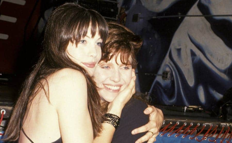 Liv Tyler and Mother Bebe Buell embrace during Liv Tyler's 16th Birthday Party - June 30, 1993