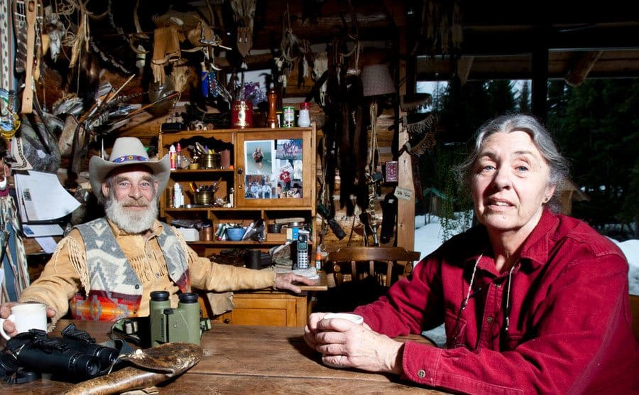Tom Oar and his wife, Nancy, relax in their humble mountain house.