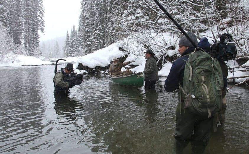 Cameramen filming on location in a freezing cold river for 'Mountain Men.'