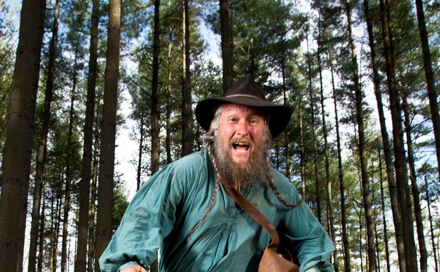 Eustace running through the woods.