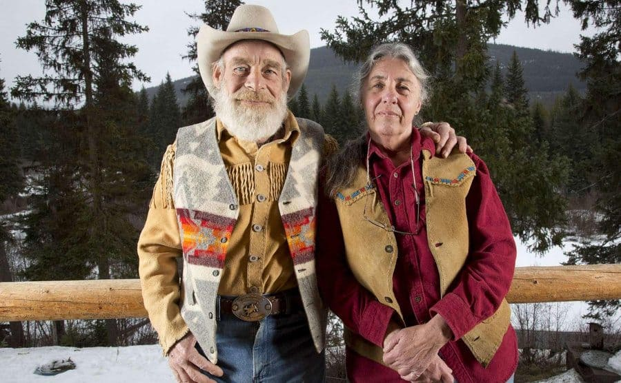 Tom and Nancy of their front porch up in the snowy mountains.