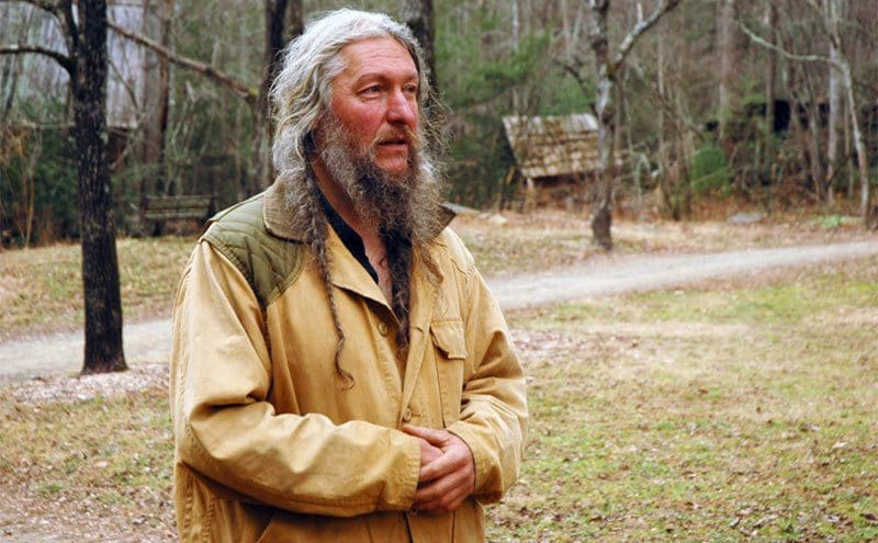 Eustace Conway explaining things about the wildness on his farm.