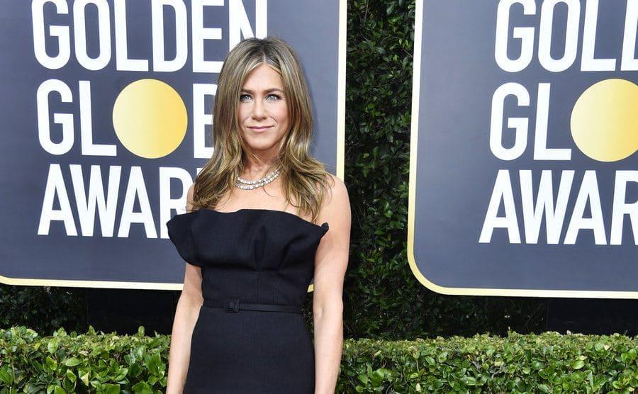 Jennifer Aniston on the red carpet in a black strapless dress