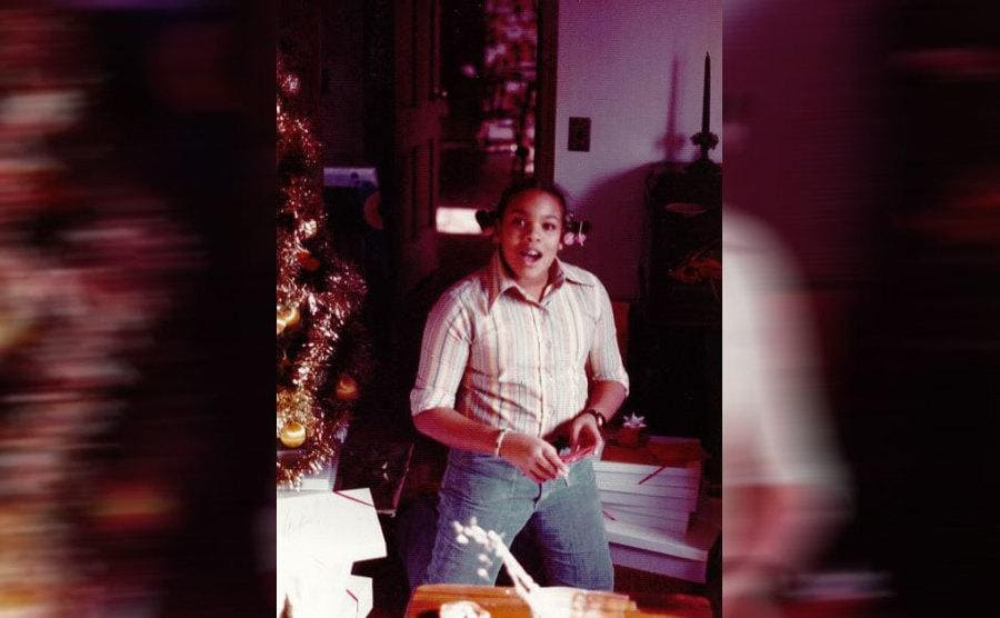 Wendy Williams as a young girl standing in her living room near the Christmas Tree