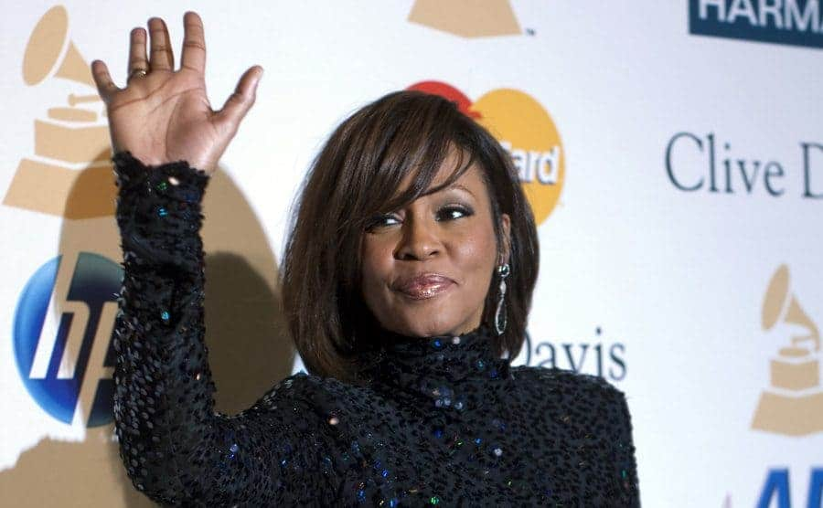 Whitney Houston arriving at an event waving