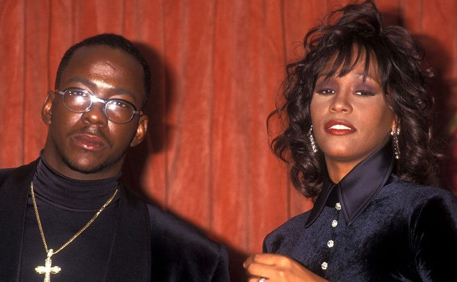 Bobby Brown and Whitney Houston at an event in 1994 posing on the red carpet