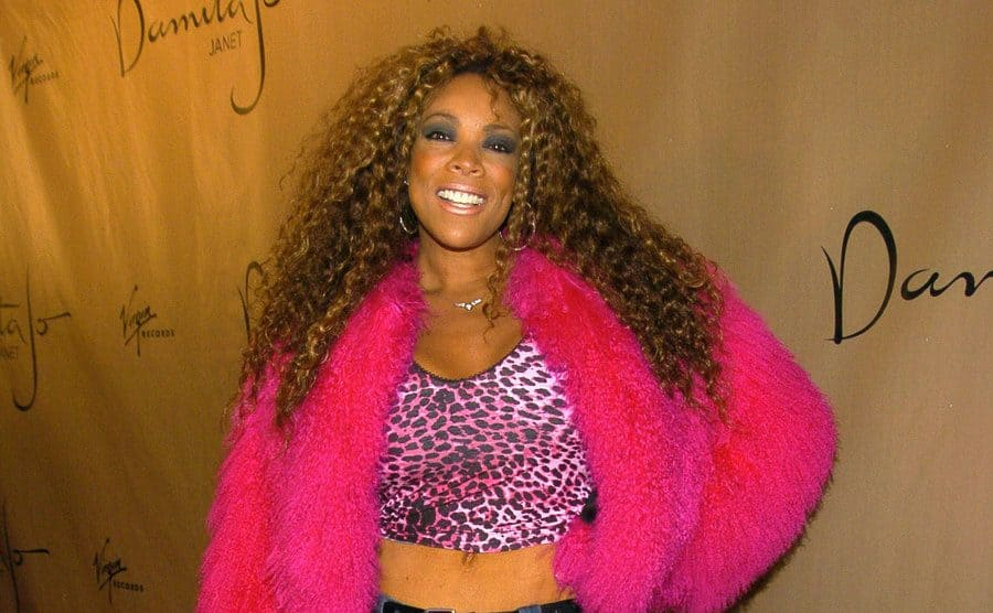 Wendy Williams on the red carpet in a hot pink fur jacket