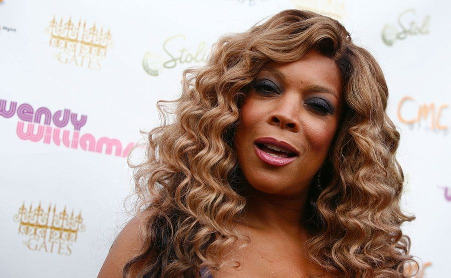 Wendy Williams posing with a side-eye on the red carpet