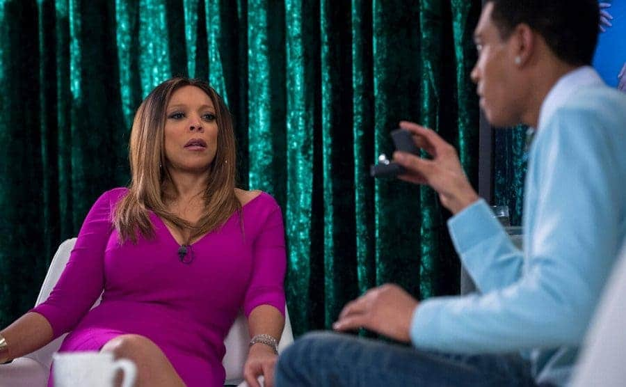 Wendy Williams being interviewed by someone holding up a box with an engagement ring in it in a scene from Law and Order: SVU