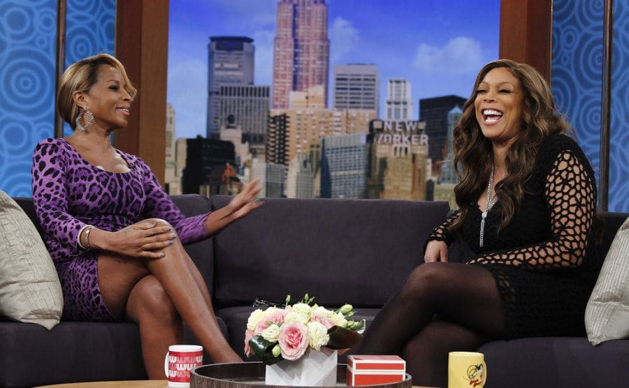 Mary J Blige and Wendy Williams laughing on her talk show