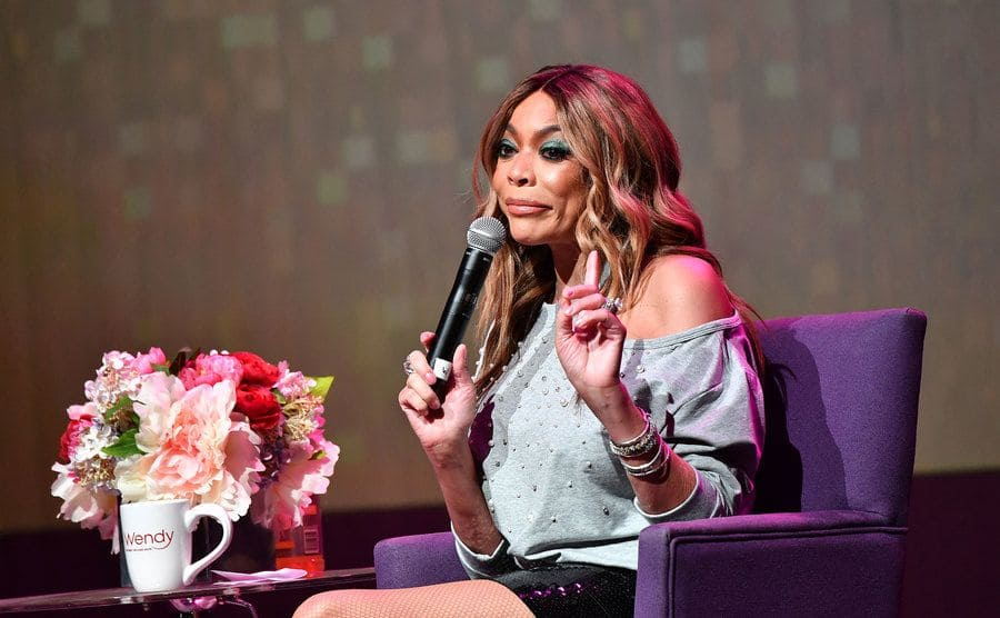 Wendy Williams with her finger up gesturing while she speaks at an event