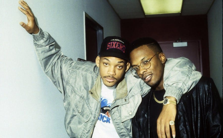 Will Smith and DJ Jazzy Jeff posing together backstage at an event