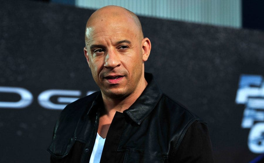 Vin Diesel sitting at a film premiere