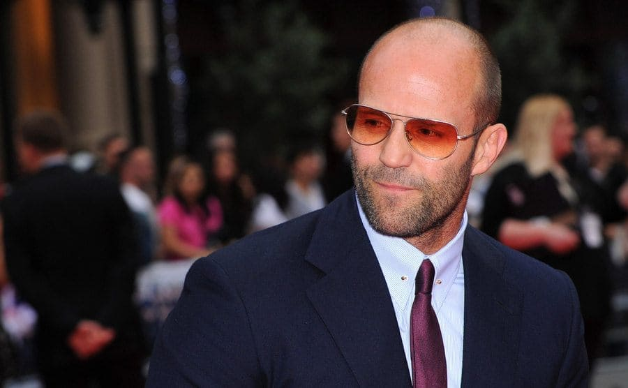 Jason Statham arriving at a red carpet event in 2014