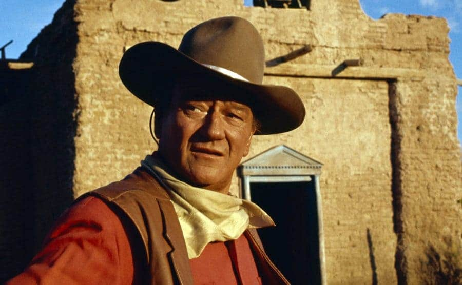 John Wayne on the set of an old Western movie