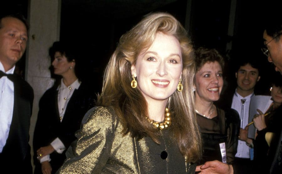 Meryl Streep on the red carpet wearing all gold