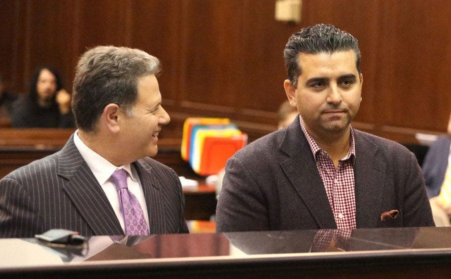 Buddy with his lawyer laughing in court