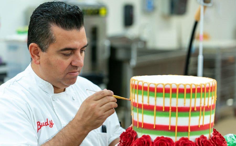 Buddy decorating a cake