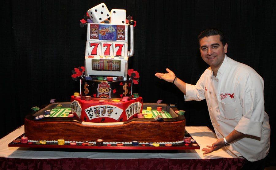 Buddy standing next to the Casino cake